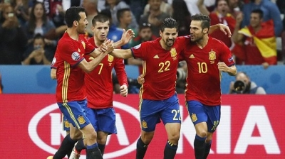 Spain cruise to last 16 after crucial win over Turkey