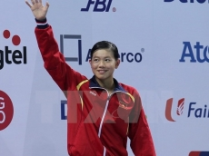 Vietnamese swimmer wins gold, setting a new Asian record
