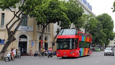 Hanoi's double-decker sightseeing bus makes first trip