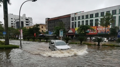 Tropical low depression brings heavy rain, flooding to northern and central regions