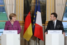 Macron, Merkel pledge common roadmap on eurozone reforms by June