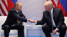 Trump says to meet with Putin in