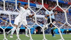 Suarez marks 100th cap with goal to send Uruguay through to last 16
