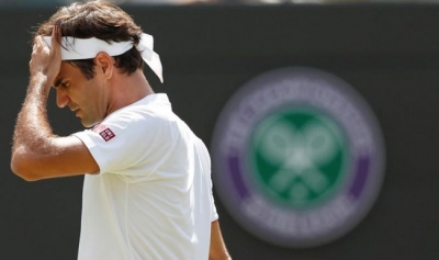 Wimbledon day nine: Federer knocked out by Anderson