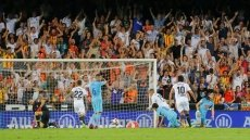 Valencia hold Atletico in thrilling Liga draw