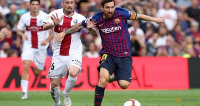Barca humiliate Huesca, Betis edge Seville derby