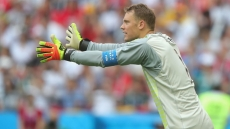 Struggling Neuer symbolic of Germany crisis