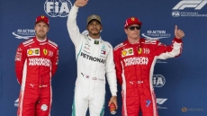 Hamilton takes US pole with fifth title in sight