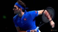 Federer outclasses Thiem to keep ATP Finals hopes alive