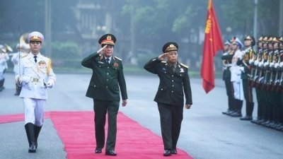 Viet Nam, Laos seek to further deepen defence ties