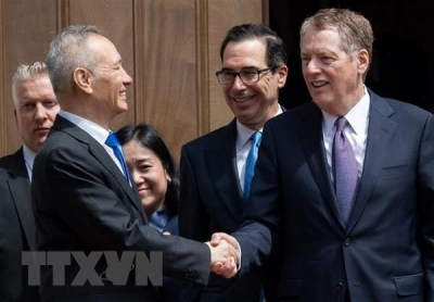 China, US insist on maintaining trade talks