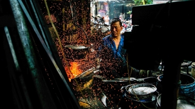 The last iron forger keeps the furnace's flame burning on Hanoi's old street