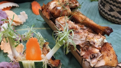 Grilled chicken in bamboo tube