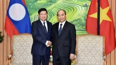 PM hosts Lao counterpart